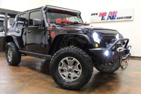2014 Jeep Wrangler Unlimited for sale at Driveline LLC in Jacksonville FL