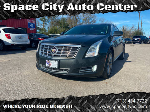 2014 Cadillac XTS for sale at Space City Auto Center in Houston TX