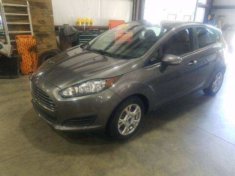 2014 Ford Fiesta for sale at Hometown Automotive Service & Sales in Holliston MA