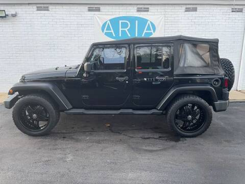 2010 Jeep Wrangler Unlimited for sale at ARIA  AUTO  SALES in Raleigh NC