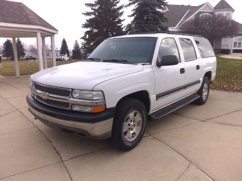 2003 Chevrolet Suburban for sale at Heartbeat Used Cars & Trucks in Harrison Twp MI