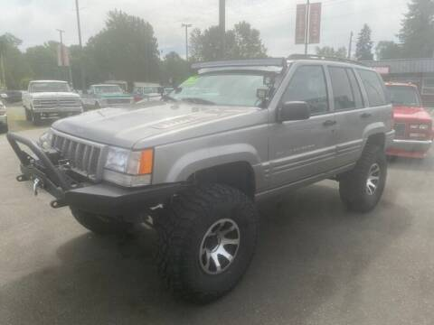 1998 Jeep Grand Cherokee for sale at MILLENNIUM MOTORS INC in Monroe WA