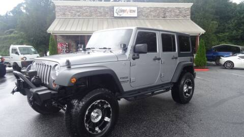 2013 Jeep Wrangler Unlimited for sale at Driven Pre-Owned in Lenoir NC