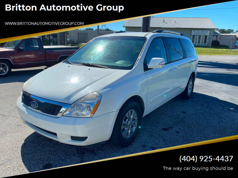 2012 Kia Sedona for sale at Britton Automotive Group in Loganville GA