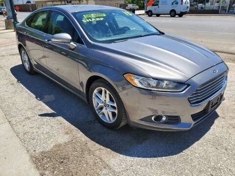 2013 Ford Fusion for sale at Street Side Auto Sales in Independence MO
