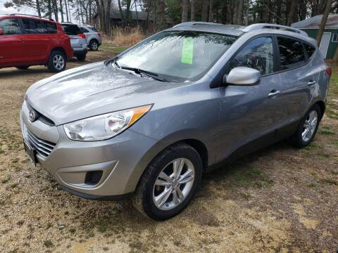 2011 Hyundai Tucson for sale at Northwoods Auto & Truck Sales in Machesney Park IL