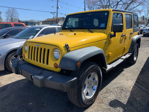 2011 Jeep Wrangler Unlimited for sale at Charles and Son Auto Sales in Totowa NJ