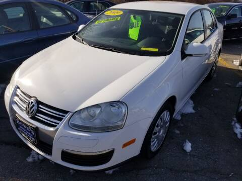 2009 Volkswagen Jetta for sale at Howe's Auto Sales in Lowell MA