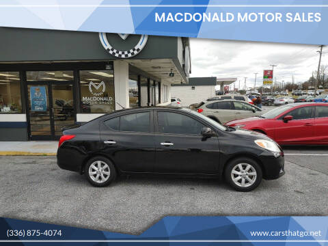 2013 Nissan Versa for sale at MacDonald Motor Sales in High Point NC