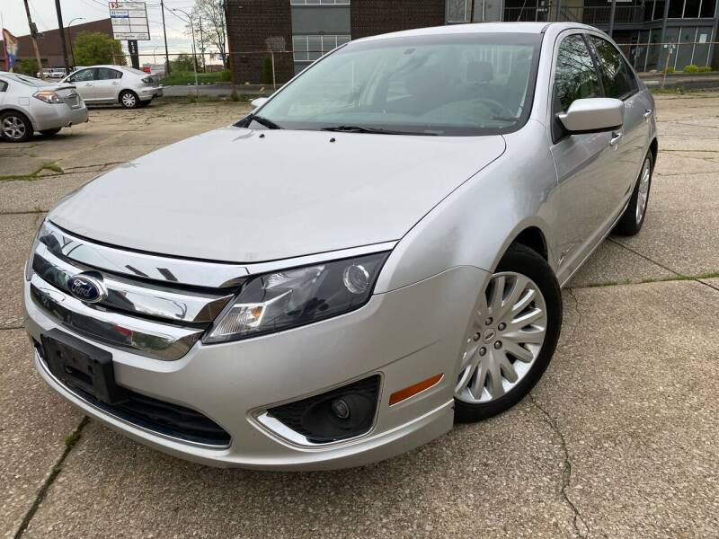 2012 Ford Fusion Hybrid for sale at Cedar Auto Group LLC in Akron OH