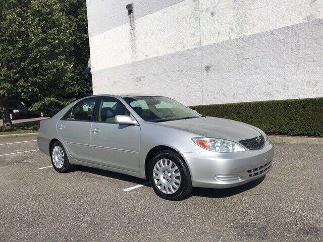 2002 Toyota Camry for sale at Select Auto in Smithtown NY