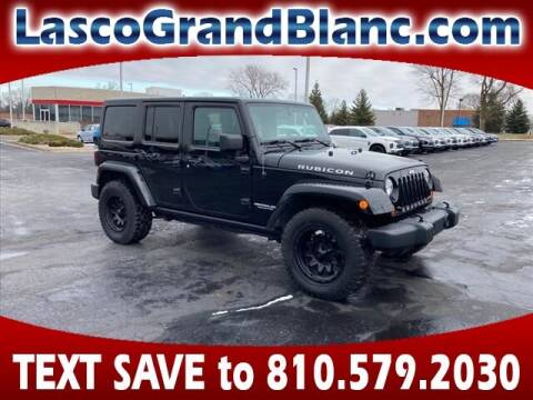 2013 Jeep Wrangler Unlimited for sale at Lasco of Grand Blanc in Grand Blanc MI