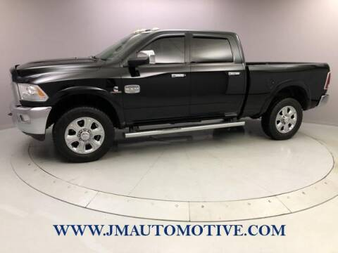 2013 RAM Ram Pickup 2500 for sale at J & M Automotive in Naugatuck CT