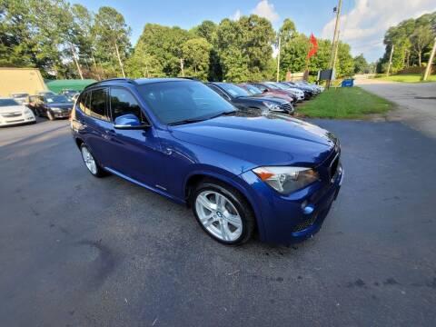 2013 BMW X1 for sale at GEORGIA AUTO DEALER, LLC in Buford GA