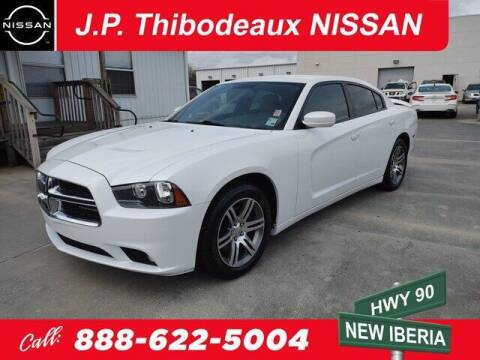 2013 Dodge Charger for sale at J P Thibodeaux Used Cars in New Iberia LA