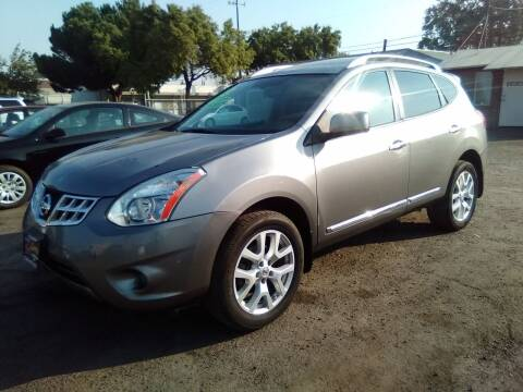 2013 Nissan Rogue for sale at Larry's Auto Sales Inc. in Fresno CA