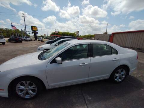 2012 Ford Fusion for sale at BIG 7 USED CARS INC in League City TX