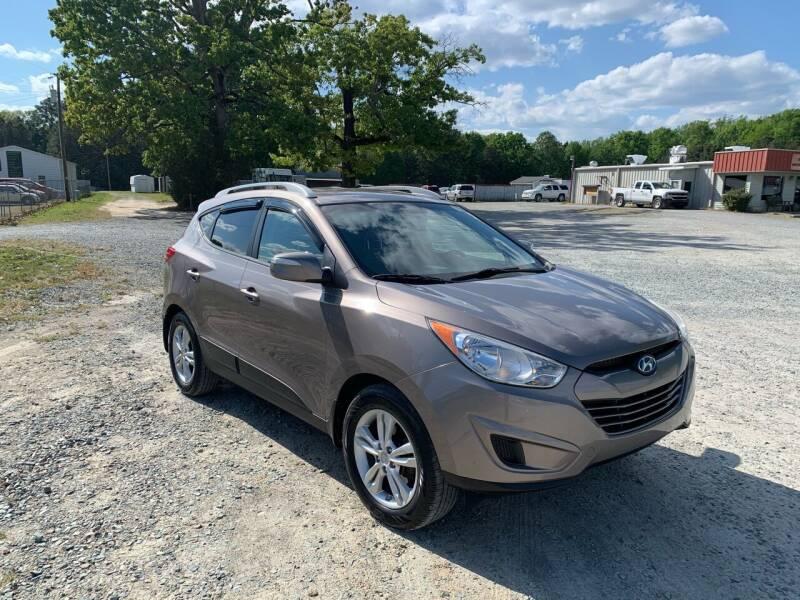 2012 Hyundai Tucson for sale at Sanford Autopark in Sanford NC