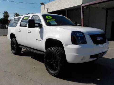 2011 GMC Yukon XL for sale at Bell's Auto Sales in Corona CA