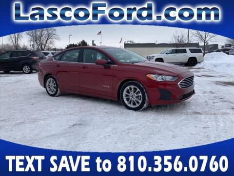 2019 Ford Fusion Hybrid for sale at LASCO FORD in Fenton MI