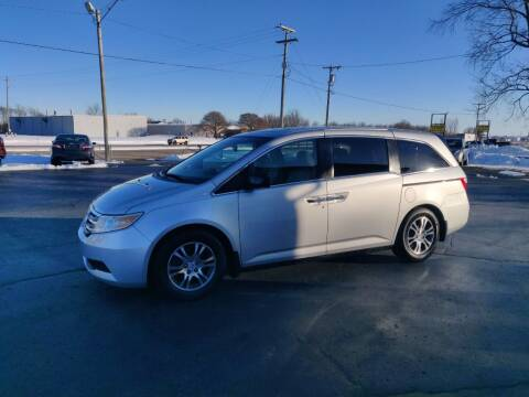 2013 Honda Odyssey for sale at Carmart Auto Sales Inc in Schoolcraft MI