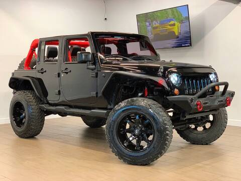 2014 Jeep Wrangler Unlimited for sale at TX Auto Group in Houston TX
