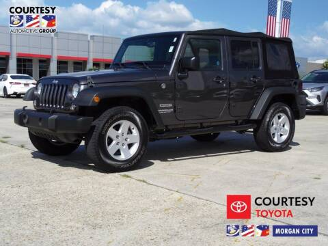 2017 Jeep Wrangler Unlimited for sale at Courtesy Toyota & Ford in Morgan City LA