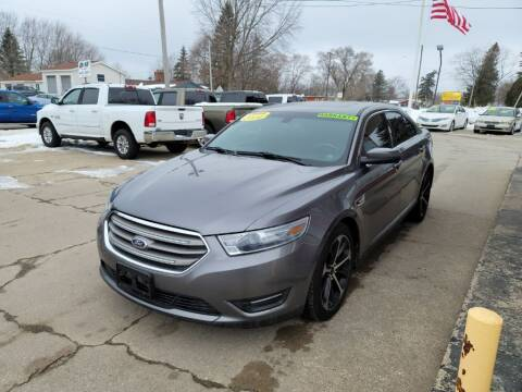 2014 Ford Taurus for sale at Clare Auto Sales, Inc. in Clare MI