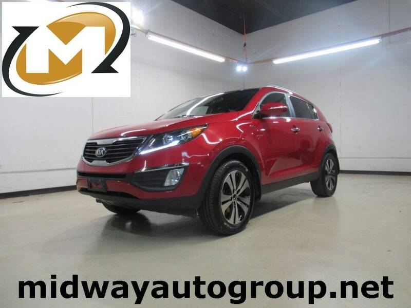2013 Kia Sportage for sale at Midway Auto Group in Addison TX