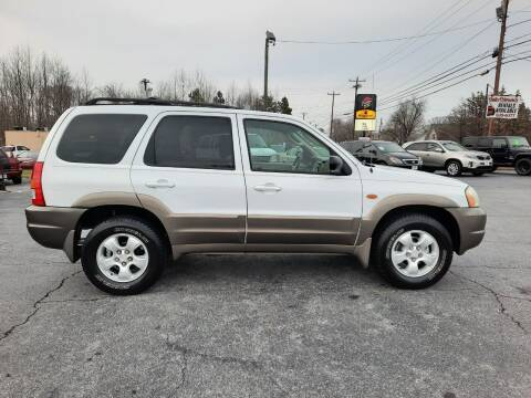 2004 Mazda Tribute for sale at G AND J MOTORS in Elkin NC