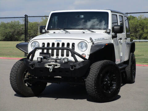 2014 Jeep Wrangler Unlimited for sale at Ritz Auto Group in Dallas TX