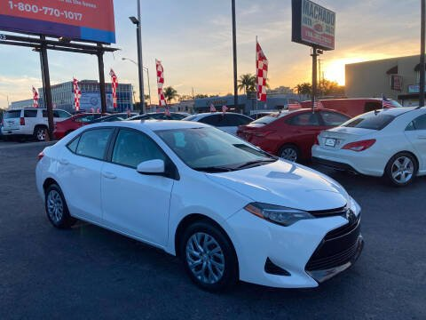 2019 Toyota Corolla for sale at MACHADO AUTO SALES in Miami FL