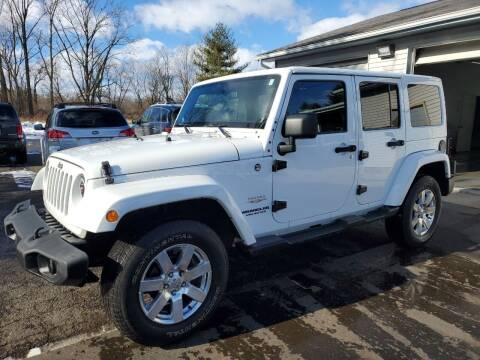 2012 Jeep Wrangler Unlimited for sale at Drive Motor Sales in Ionia MI