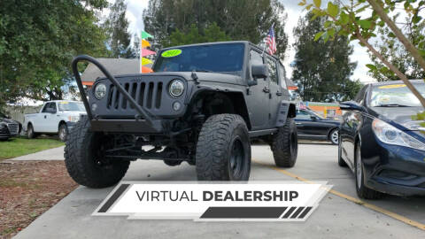 2011 Jeep Wrangler Unlimited for sale at GP Auto Connection Group in Haines City FL