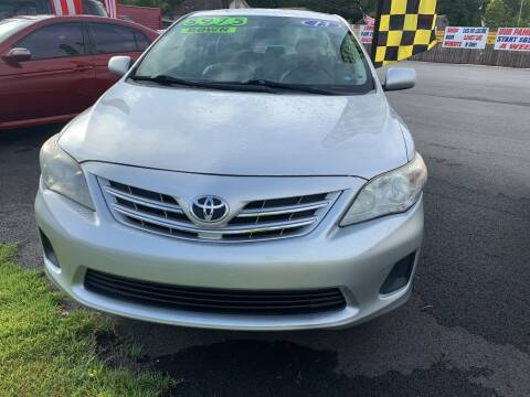 2013 Toyota Corolla for sale at Cars for Less in Phenix City AL