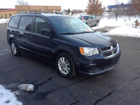 2014 Dodge Grand Caravan for sale at Bruns & Sons Auto in Plover WI