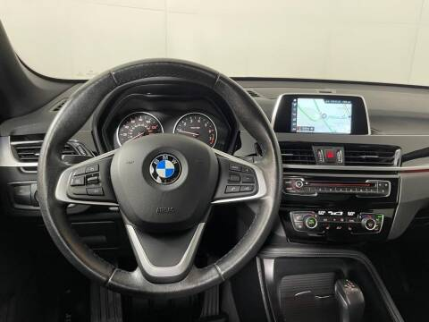 2018 BMW X1 for sale at CU Carfinders in Norcross GA