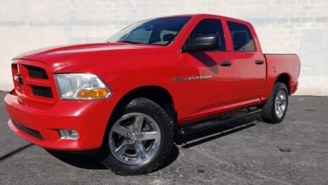 2012 RAM Ram Pickup 1500 for sale at AUTO FIESTA in Norcross GA