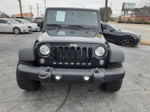 2014 Jeep Wrangler Unlimited for sale at LOS PAISANOS AUTO & TRUCK SALES LLC in Peachtree Corners GA
