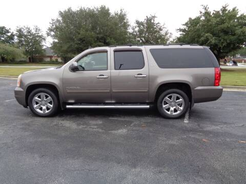 2011 GMC Yukon XL for sale at BALKCUM AUTO INC in Wilmington NC