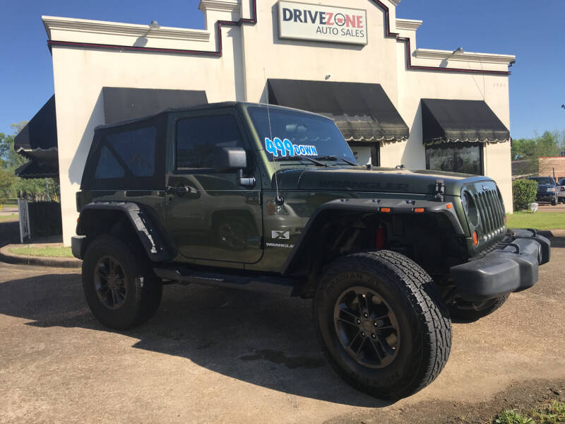 2009 Jeep Wrangler for sale at DRIVE ZONE AUTOS in Montgomery AL