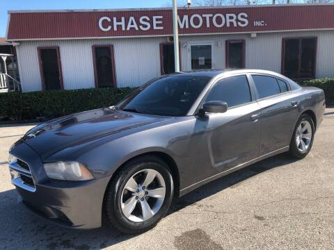 2013 Dodge Charger for sale at Chase Motors Inc in Stafford TX