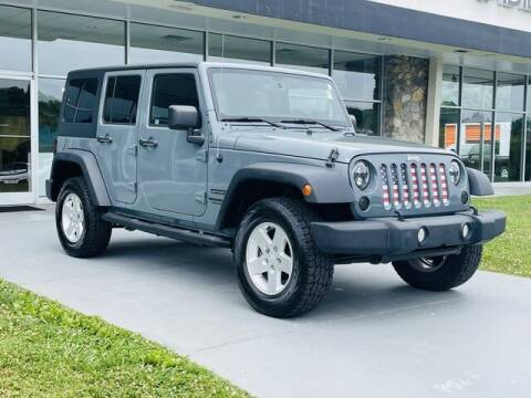 2014 Jeep Wrangler Unlimited for sale at RUSTY WALLACE CADILLAC GMC KIA in Morristown TN