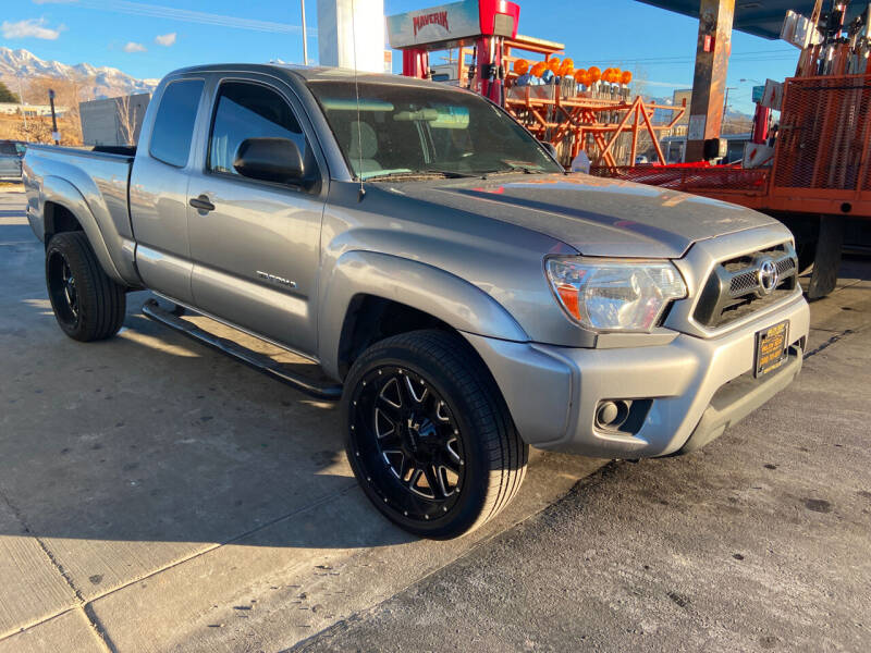 2015 Toyota Tacoma for sale at BELOW BOOK AUTO SALES in Idaho Falls ID