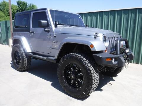 2013 Jeep Wrangler for sale at Triple C Auto Sales in Gainesville TX