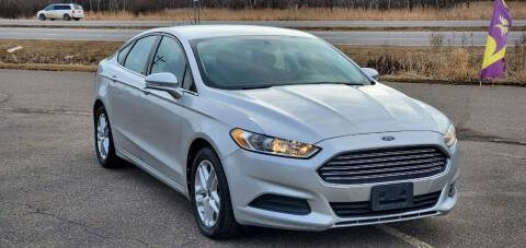 2013 Ford Fusion for sale at Transmart Autos in Zimmerman MN
