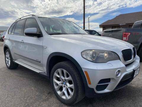 2011 BMW X5 for sale at BERKENKOTTER MOTORS in Brighton CO