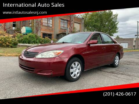 2002 Toyota Camry for sale at International Auto Sales in Hasbrouck Heights NJ