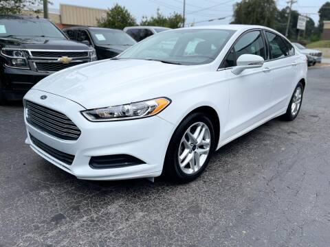 2013 Ford Fusion for sale at Magic Motors Inc. in Snellville GA
