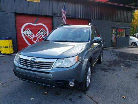 2010 Subaru Forester for sale at Apple Auto Sales Inc in Camillus NY